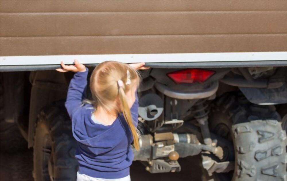 girl-opening-garage-door